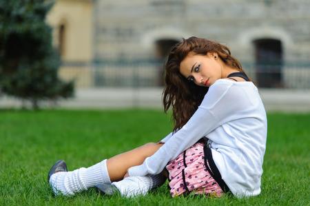 bogazici: Attractive short skirt young girl sitting on the grass in bogazici universitesi Turkey Stock Photo