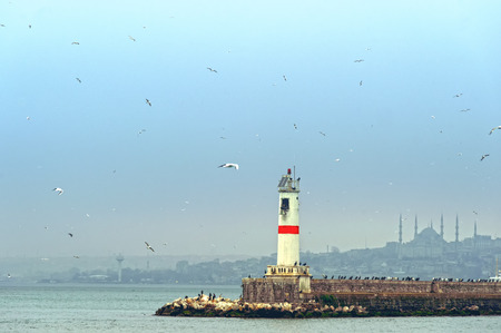 Lighthouse at the jetty in Istanbul Kadikoy Turkey winter evening time photo