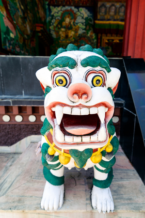 sacrosanct: Lion sculpture at main gate of Kopan Monastery temple in Kathmandu Stock Photo