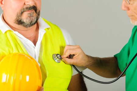 hard hat labor at medical doctor examination isolated background Stock Photo - 32804115