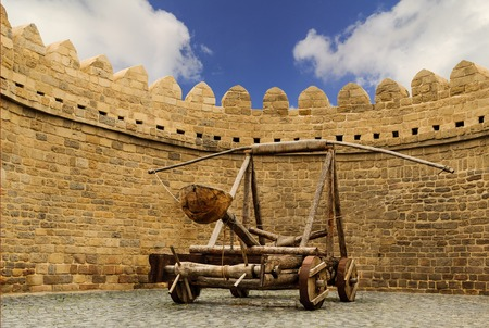 counterpoise: catapult wooden Turkish Mancinik in city wall Icheri Sheher (Old Town) of Baku Azerbaijan