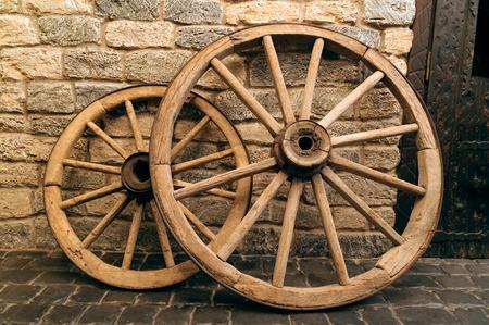rustic wagon wheels in front of the wall in old city Baku, Azerbaijan photo