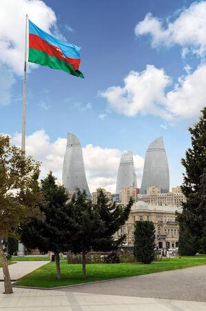 BAKU, AZERBAIJAN - OCTOBER 17, 2014: View of the Flame Towers skyscraper with azerbaijan flag in Baku on October 17, 2014. Baku will host the 2015 European Games.