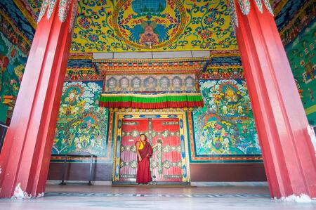 sacrosanct: KATHMANDU, NEPAL - AUGUST 27, 2011: Embroidered main gate of Kopan Monastery.Kopan Monastery had its beginnings in the Solukhumbu region of the Himalayan mountains in 1971