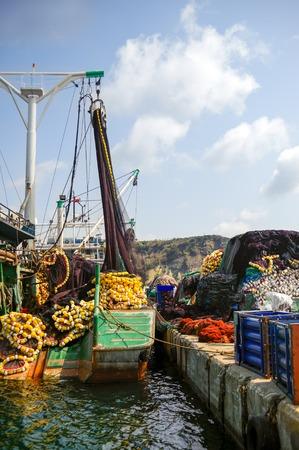 fishnet: Fishing boat with colorful fishnet sunset in Poyrazkoy Istanbul, Turkey Stock Photo