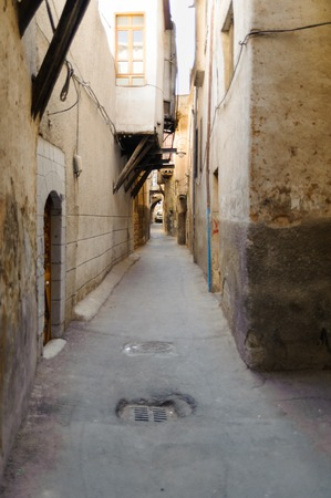 sham: DAMASCUS, SYRIA - NOVEMBER 16, 2012: Narrow street view in Damascus Sham. Damascus was conquered by Alexander the Great. After the death of Alexander in 323 BC.