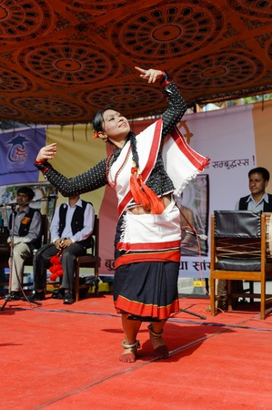 originated: KATHMANDU, NEPAL - MAY 17, 2014: Nepali  girl dancer performing traditional Nepal dance called Hijo Rati Sapani Ma Nepali Dance in Kathmandu. Legends state that dances in the Indian subcontinent originated in the abode of Lord Shiva the Himalayas and the
