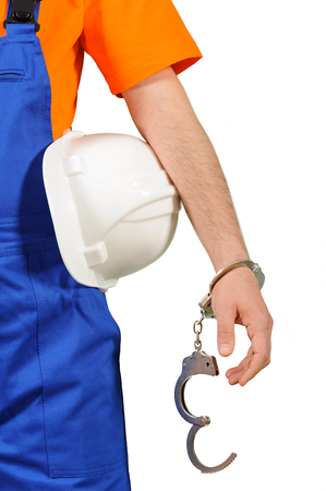 blue collar: failure guilty laborer regretful criminal handcuffed hard hat blue collar portrait