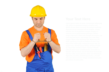 blue collar: failure guilty laborer regretful criminal handcuffed hard hat blue collar portrait on white background