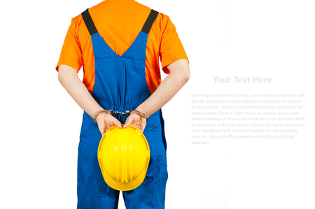 blue collar: failure guilty laborer regretful criminal handcuffed hard hat blue collar portrait on white Stock Photo
