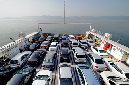 boat: ISTANBUL TURKEY  MAY 17 2015:  Top view of vehicle and passenger ferry boat. Ferry boats often dock at specialized facilities designed to position the boat for loading and unloading called a ferry slip. Editorial