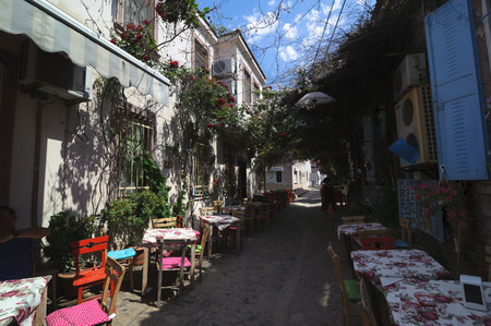 BALIKESIR TURKEY  MAY 18 2015: Narrow streets of old touristic town Cunda Alibey Island Ayvalik.  It is a small island in the northwestern Aegean Sea off the coast of Ayvalik in Balikesir Turkey. Editorial