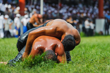 EDIRNE TURKEY  JULY 06 2013: Wrestlers Turkish pehlivan at the competition in traditional Kirkpinar wrestling. Krkpnar is a Turkish oilwrestling Turkish: yagli gures tournament.It is held annually usually in late June near Edirne Turkey since 1346.