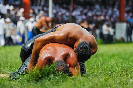 edirne: EDIRNE TURKEY  JULY 06 2013: Wrestlers Turkish pehlivan at the competition in traditional Kirkpinar wrestling. Krkpnar is a Turkish oilwrestling Turkish: yagli gures tournament.It is held annually usually in late June near Edirne Turkey since 1346.