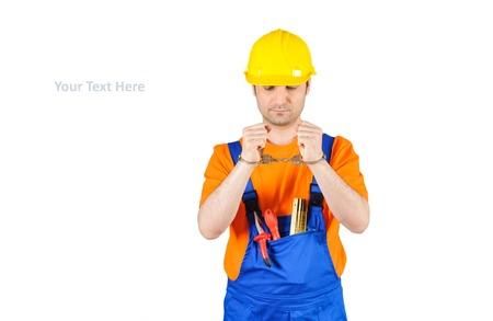 laborer: failure guilty laborer regretful criminal handcuffed hard hat blue collar portrait on white background