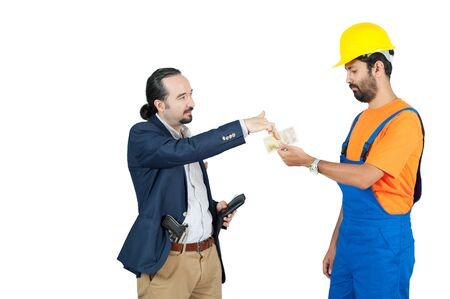 businessman paying hired blue collar laborer for services isolated on the white background Stock Photo