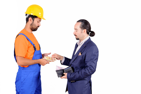 laborer: businessman paying hired blue collar laborer for services isolated on white background.