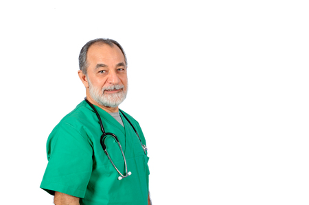 experienced operator: senior male surgery operator doctor with green uniform portrait isolated on white background Stock Photo