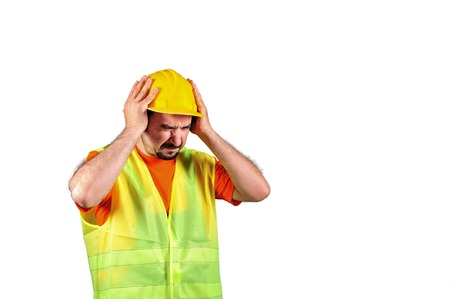 preventing: Manuel worker protecting himself from noisy environment isolated on white background Stock Photo