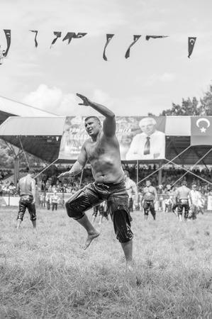wrestling: EDIRNE, TURKEY - JULY 26, 2010: Wrestlers Turkish pehlivan at the competition in traditional Kirkpinar wrestling. Kirkpinar is a Turkish oil-wrestling (Turkish: yagli gures) tournament.