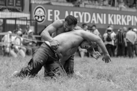 edirne: EDIRNE, TURKEY - JULY 26, 2010: Wrestlers Turkish pehlivan at the competition in traditional Kirkpinar wrestling. Kirkpinar is a Turkish oil-wrestling (Turkish: yagli gures) tournament.