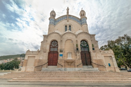 ile de la cite: ALGIERS, ALGERIA - APRIL 8, 2016: Cathedral of Notre dame dAfrique, Algiers Algeria. The basilica was inaugurated in 1872, after fourteen years of construction. Editorial