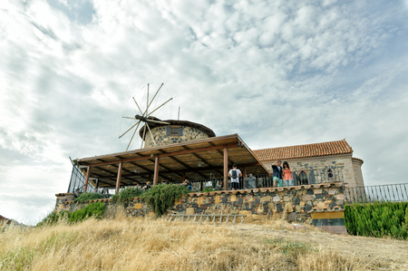 posterity: BALIKESIR, TURKEY - MAY 21 2016:Library of Sevim and Necdet Kent.Windmill and church were restored with the financial support of Rahmi Koc thereby saving monuments to cultural heritage for posterity