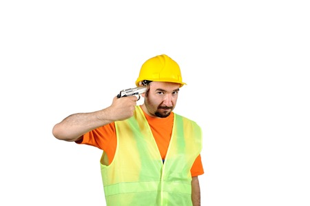 failure sadness guilty manuel worker regretful gun in hand isolated on white portrait. Stock Photo