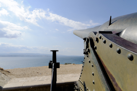 ww1: Rumeli Mecidiye emplacement fort (Turkish Tabya) Krupp cannon barrel and dardanel sea view perspective. This cannon hit HMS Ocean battleship of the British Royal Navy ship on 18 march 1915 at gallipoli ww1. Editorial