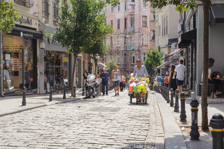 ISTANBUL, TURKEY- SEP 10 2016: Yuksek kaldirim street is an old commercial area of GalataKarakoy quarter of Istanbul, Turkey. Ashkenazi Synagogue is placed on this street. There are many shops beyond Editorial