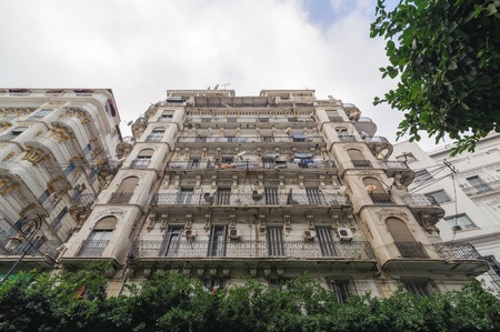 algiers: ALGIERS, ALGERIA - SEP 30, 2016:French colonial buildings in Algiers Algeria.Buildings are being renovated by Algerian government.