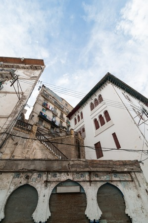 algiers: ALGIERS, ALGERIA - FEB 6, 2016: An ancient part of old city of Algeria, called casbah(kasaba).Old city is 122 metres (400 ft) above the sea. The casbah and the two quays form a triangle
