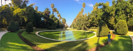 ALGIERS, ALGERIA - SEP 24, 2016:Big pool and trees in Botanical Garden of Hamma in Algiers.It was established in 1832 and now still considered one of the most important botanical gardens in the world