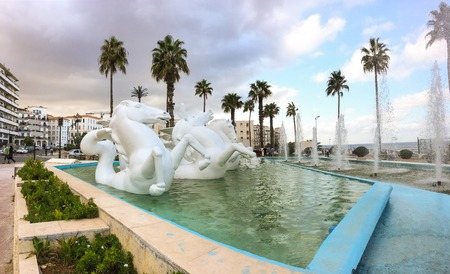 ALGIERS, ALGERIA - SEP 24, 2016: Sculpture of horse and swimming pool in front of National institute of music of Algiers. Pool and Institute is located near by old city Casbah. Editorial