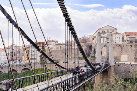 passerby: CONSTANTINE, ALGERIA - MARCH 07, 2017:The cliff of near by the suspension bridge or footbridge of Sidi MCid.The geography of the city itself is unique.Constantine one of the oldest cities in the world Editorial