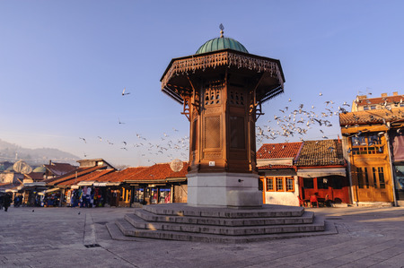 SARAJEVO, BOSNIA - JAN 26, 2018: The Sebilj is a pseudo-Ottoman style wooden fountain in the centre of Pigeon Square bascarsija square. Orijinal Sebilj destructed by Serbian bombs. Editorial