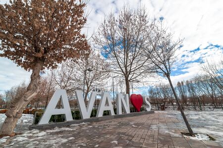 AVANOS, TURKEY - JAN 23, 2019: Avanos town name sculpture near by the kizilirmak river on snowy Winter. Avanos is a touristic town and district of Nevsehir Province in the Central Anatolia region of Turkey Editorial
