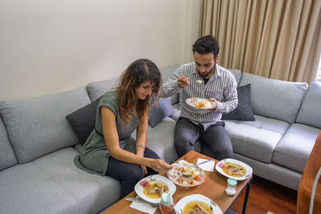 handsome man and beautiful woman have lunch in living room lifestyle concept with copy space