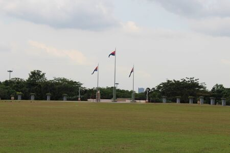 Three Flags of Johor States in Open Area in a Beautiful Park Stock Photo