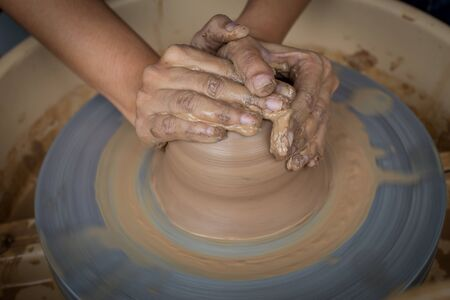 potter: Old potter creating a new ceramic pot Stock Photo