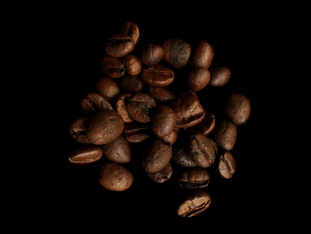 columbian: Luxurious aromatic coffee beans on black background. Luxurious coffee concept Stock Photo