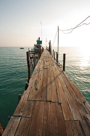 wooden bridge to the sea photo