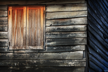 window in the old wooden house  photo