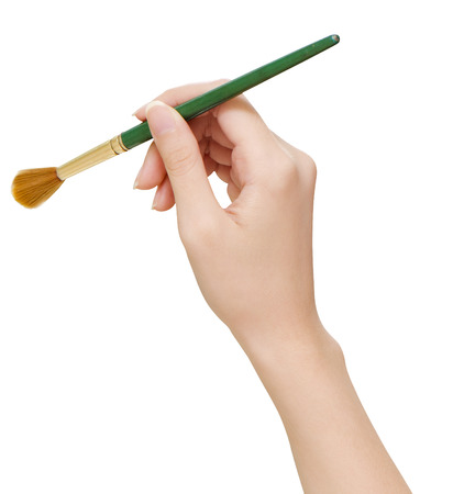 teenaged girls: A womans hand holding a paintbrush