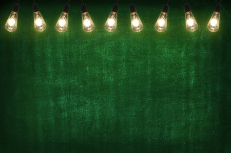 Green chalkboard compose wtih open light bulb