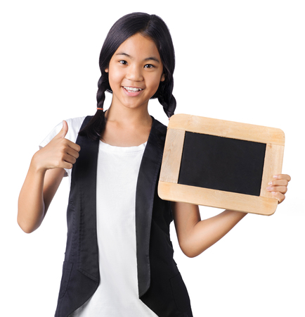 Portrait of a young girl hands holding the chalkboard on white background