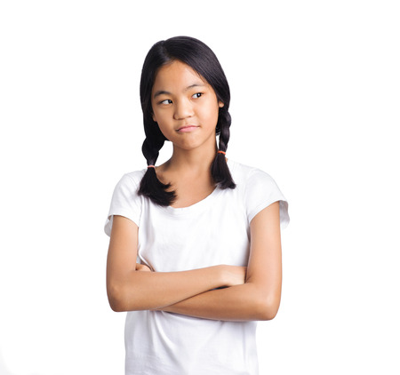young serious angry girl portrait on a white background Stockfoto