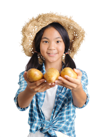 gardener girl carrying fresh potato portrait in studio Stockfoto
