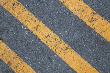 Traffic line Asphalt as abstract background or backdrop,hat be warning about not smooth surface or it is slope on the road.