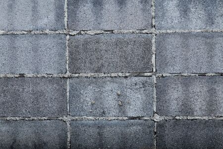 The fence is made of concrete blocks.White misty brick wall texture, brick wall background 写真素材